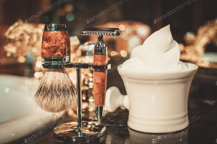 Shaving accessories in a luxury bathroom interior.