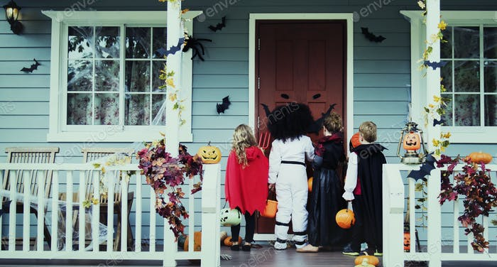Little children trick or treating