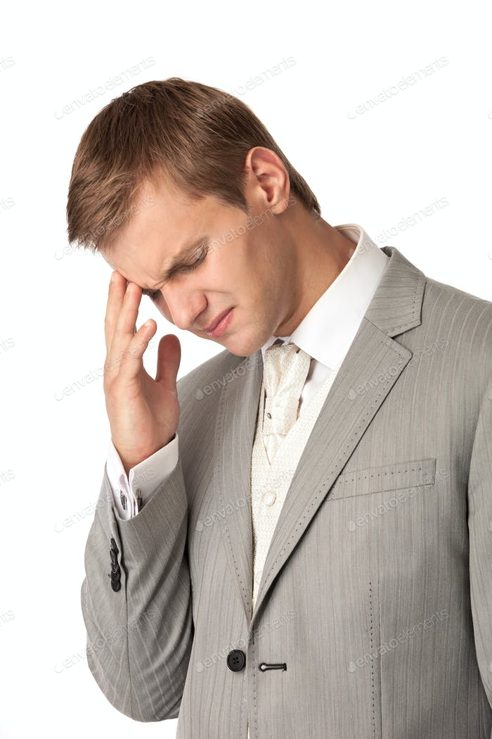 Young man in suit suffering from bad headache