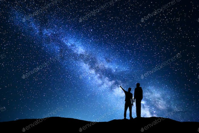Night landscape with Milky Way and silhouette of men