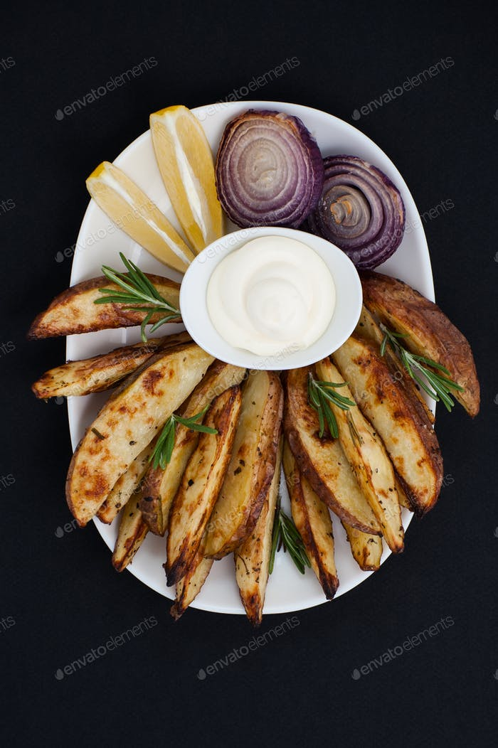 Baked potatoes and red lus with rosemary, lemon and aioli sauce