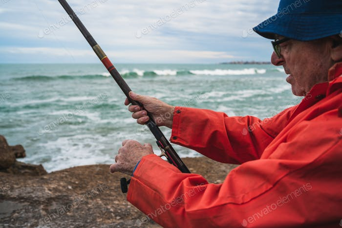 Senior man fishing in the sea.