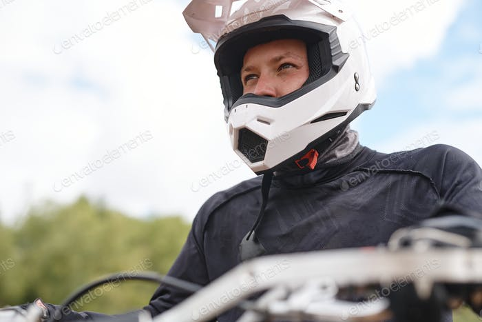 Motorcyclist looking into distance