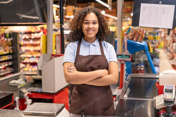 Young successful mixed-race sales clerk in workwear crossing her arms by chest
