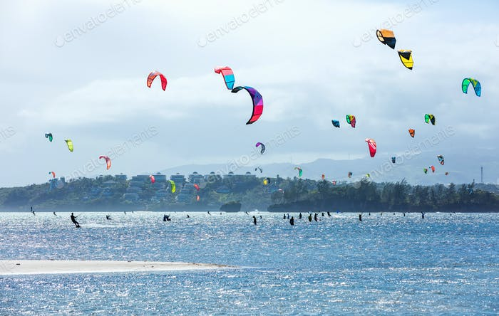 Kitesurfers enjoying wind power on Bulabog beach.