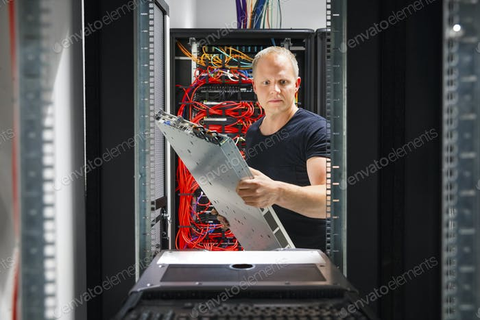 IT Engineer Arranging Server At Datacenter