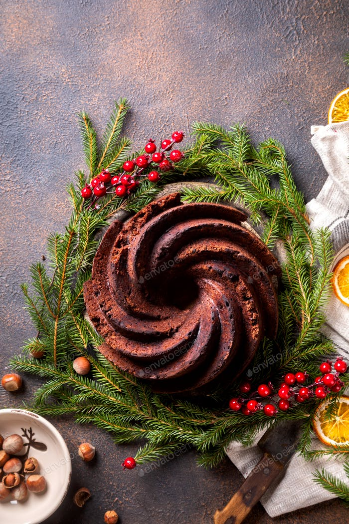 Christmas Fruit Cake, Pudding on on holiday background.