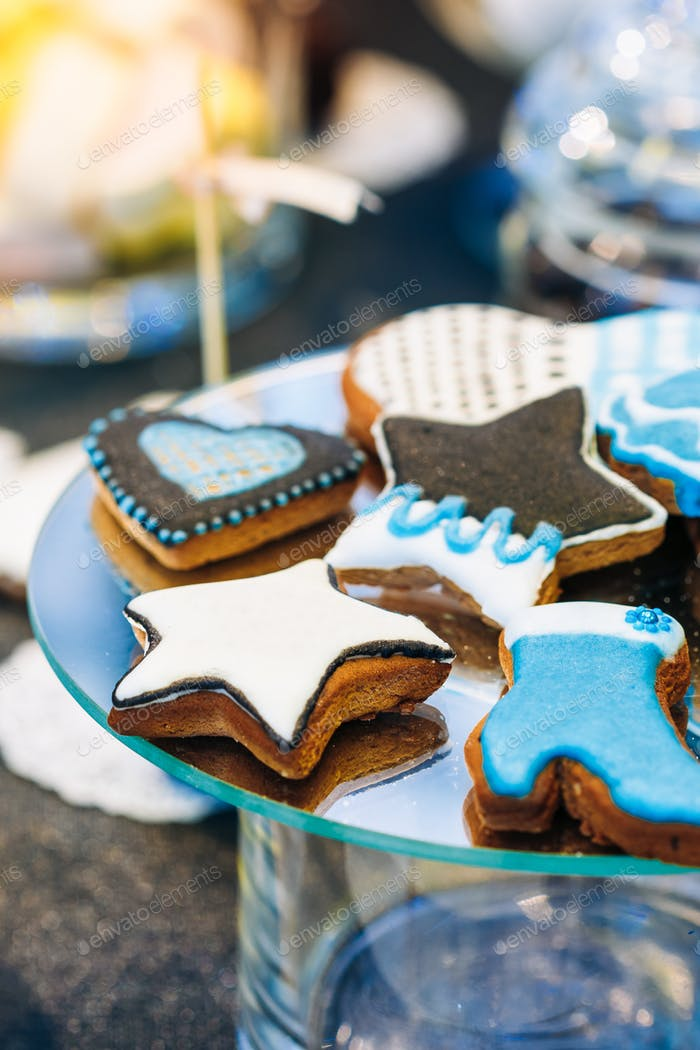 Dessert Sweet Cookies in shape of a star and a boot in Candy Bar