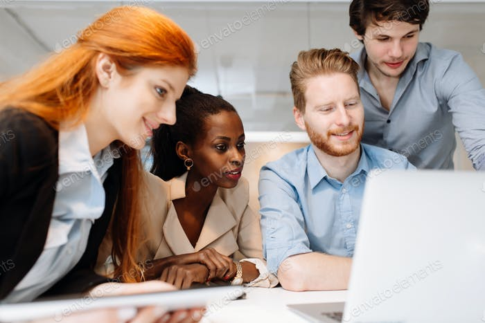 Skilled designers and business people working