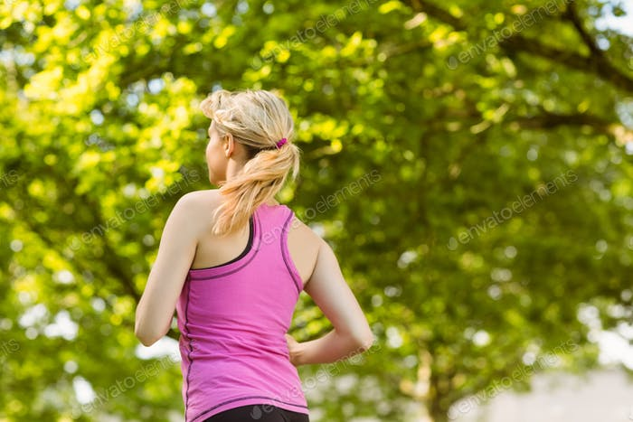 Fit blonde jogging in the park on a sunny day