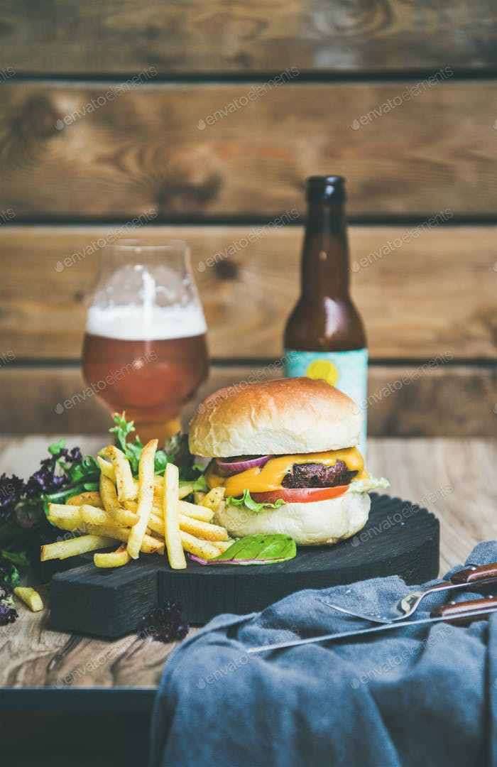 Classic burger dinner with beer and french fries