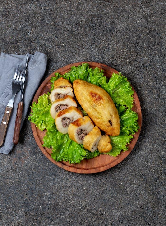 Peruvian dish called Papa Rellena , meat stuffed potato