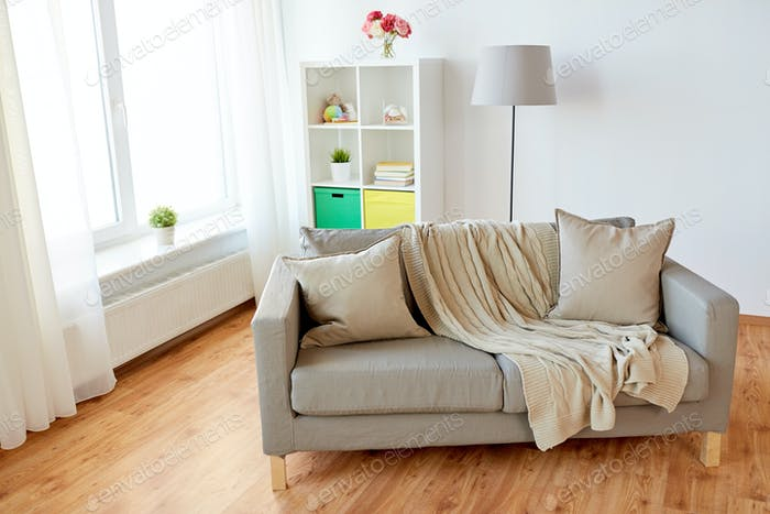 sofa with cushions at cozy home living room