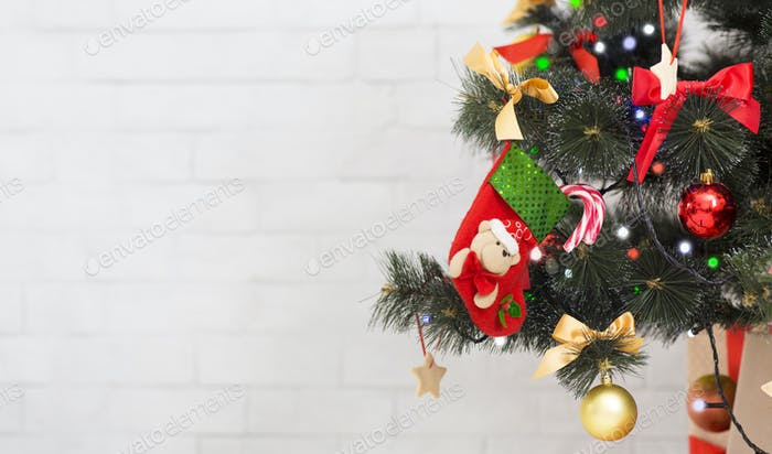 Decorated Xmas tree with kids gift sock