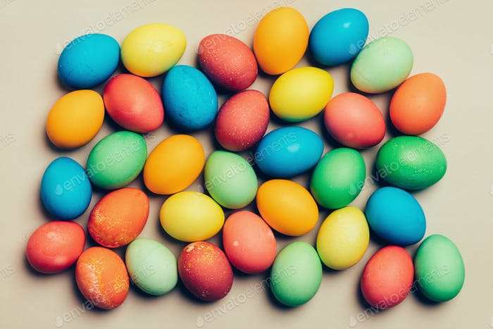 Colorful eggs on a creamy background.
