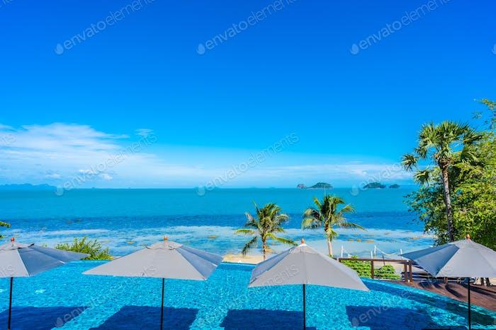 Beautiful luxury outdoor swimming pool in hotel resort with sea