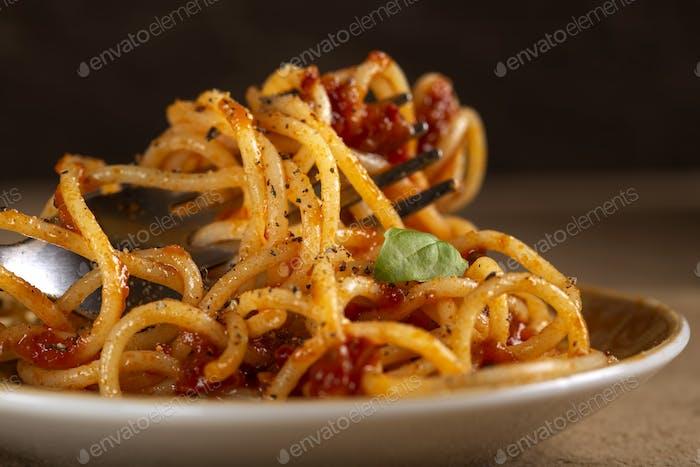 Italian pasta food with tomato sauce