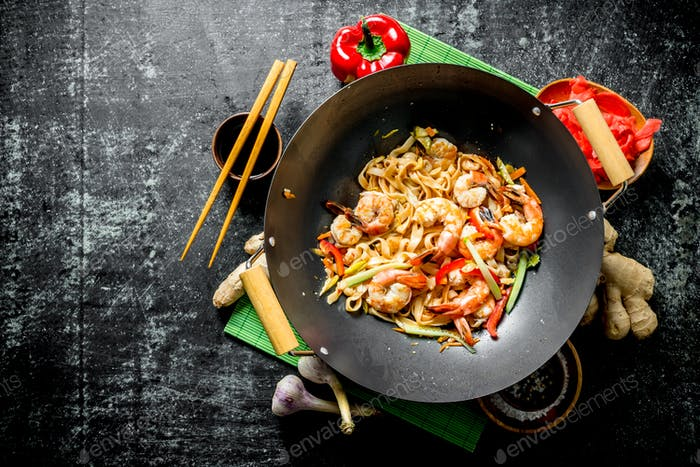 Chinese wok pasta with shrimp and fresh vegetables.