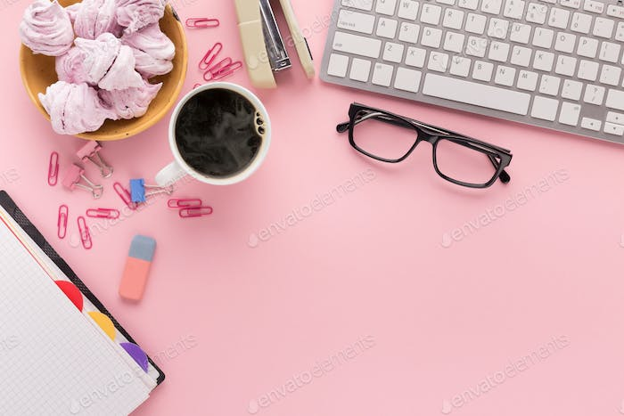 Desk with coffee cup and glasses, copy space