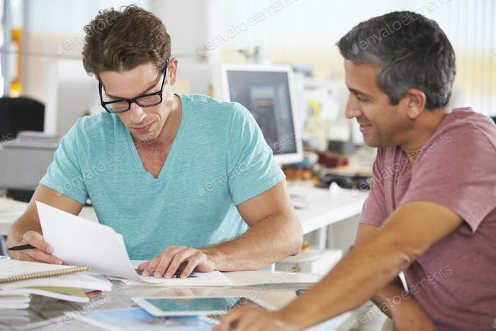 Two Men Meeting In Creative Office
