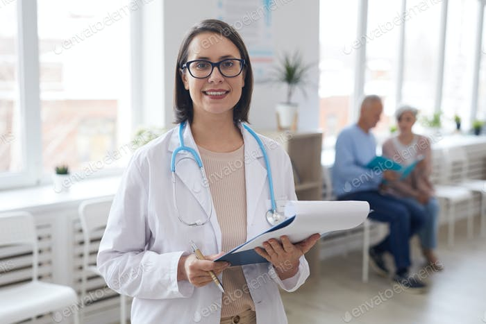 Portrait of Smiling Female Doctor in Clinic