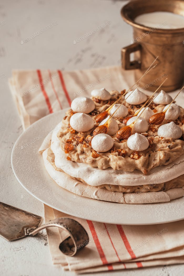 Pavlova cake with caramel and almonds
