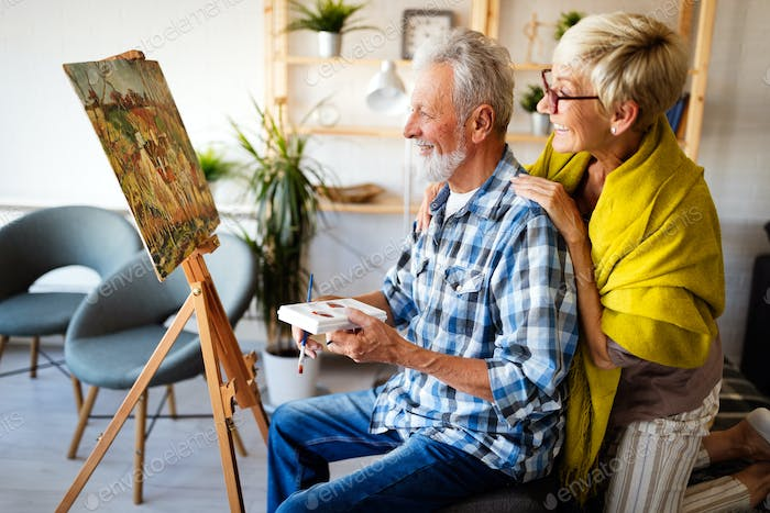 Loving senior couple relaxing at home. Mature husband and wife spending time together
