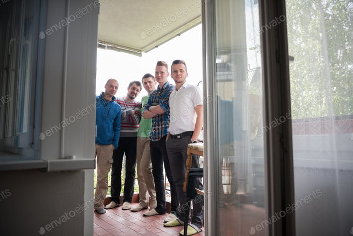 group of people standing at balcony