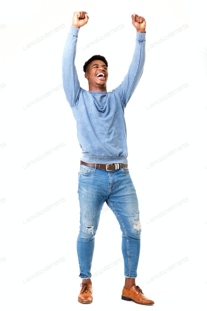 Full body cheerful young black man with arms raised against isolated white background