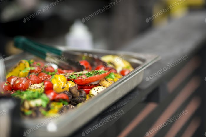 Freshly cooked hot and spicy grilled vegetables in metallic bowl
