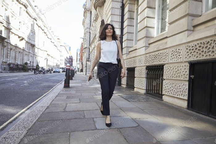 Woman walking in the street, full length