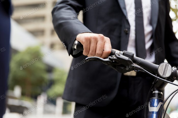Young businessman with bike