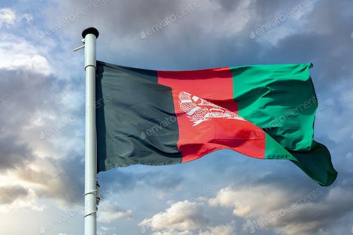 Afghanistan flag waving against cloudy sky