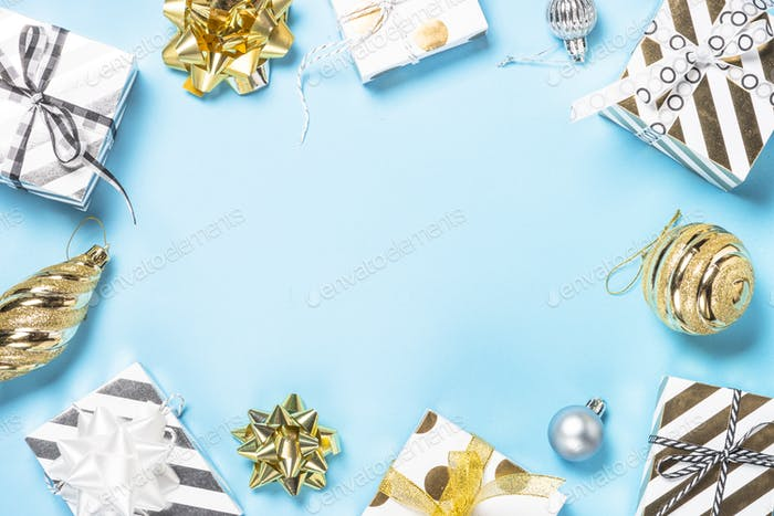 Christmas flatlay background - silver and gold decorations on blue