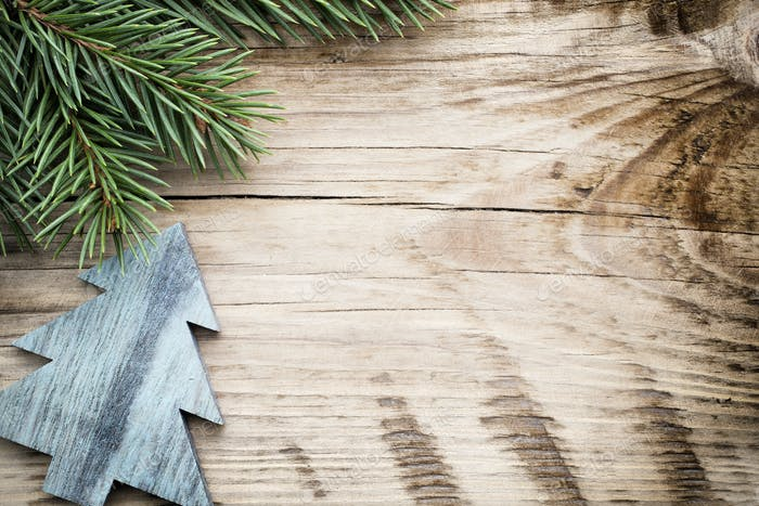 Wood texture with ornament and firtree.