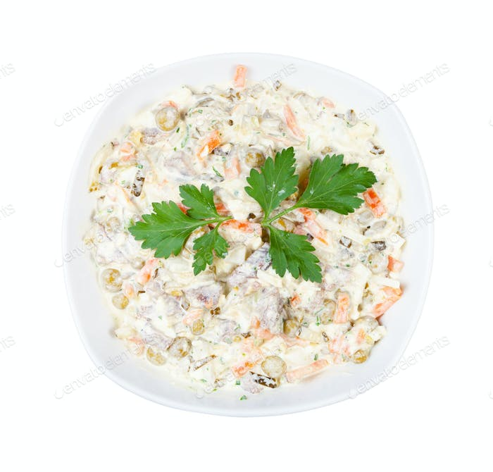 portion of Olivier salad with leaf of parsley