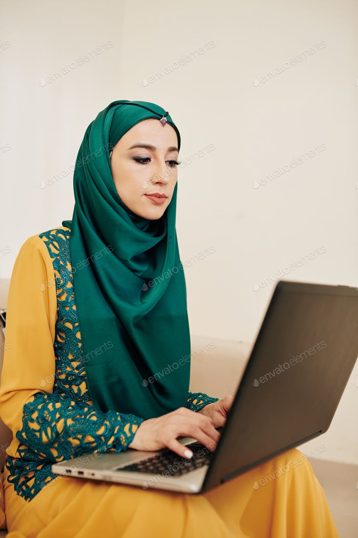 Muslim businesswoman working from home