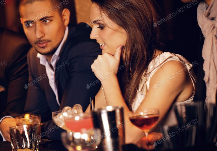 Gorgeous Woman with Boyfriend at the Bar