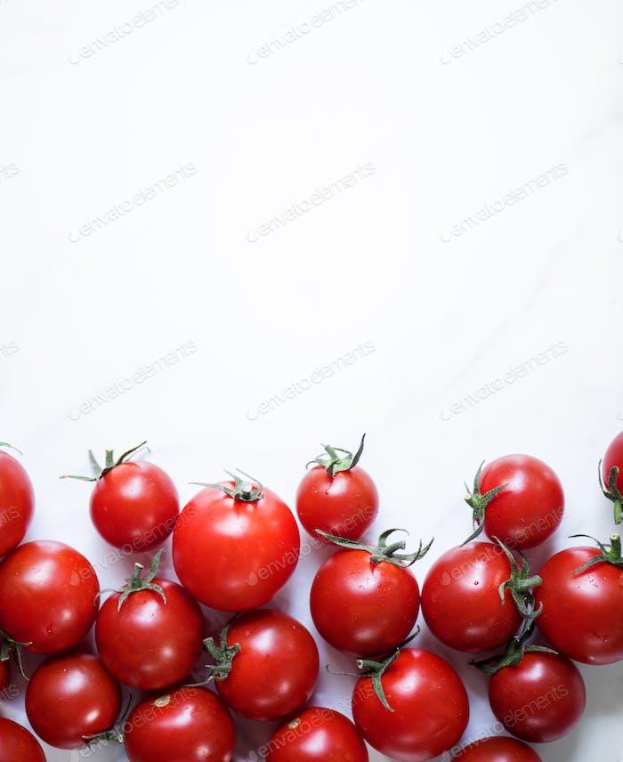 Closeup of fresh organic tomatoes on white background
