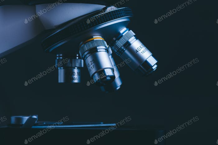 Closeup of Scientific microscope data analysis in the medical science laboratory, black background