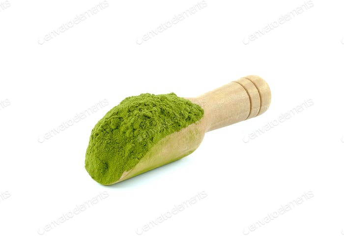 Tea powder in wood tea scoop.