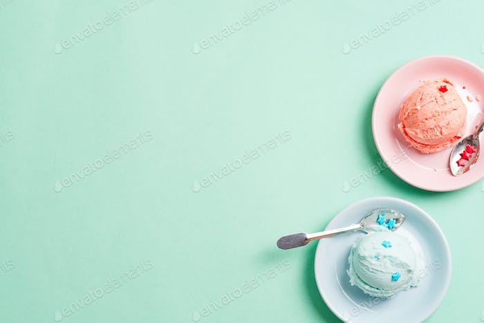 Two plates with fresh natural homemade fruits ice-cream or gelato on a blue background with copy