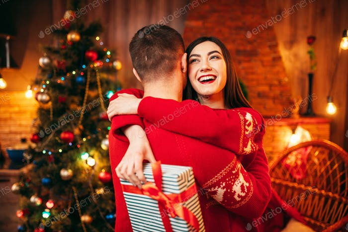 Happy love couple hugs, christmas holidays