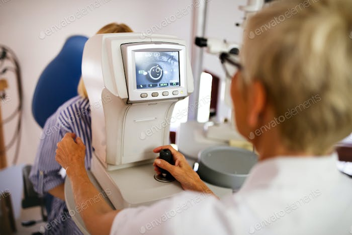 Ophthalmology eyesight diagnostic concept. Modern eye test machine equipment in clinic