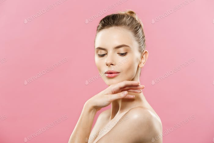Beauty skin Concept - Beautiful Young Caucasian Woman with Clean Fresh Skin look away with pink