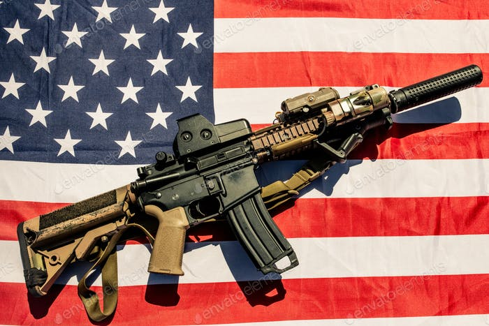 Weapon on American flag