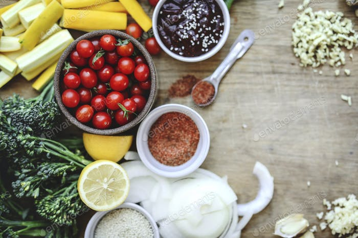 Fresh organic vegetables and ingredients prepared on a cutting board