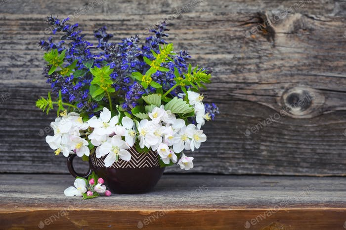 Bouquet of spring flowers on an old wooden background