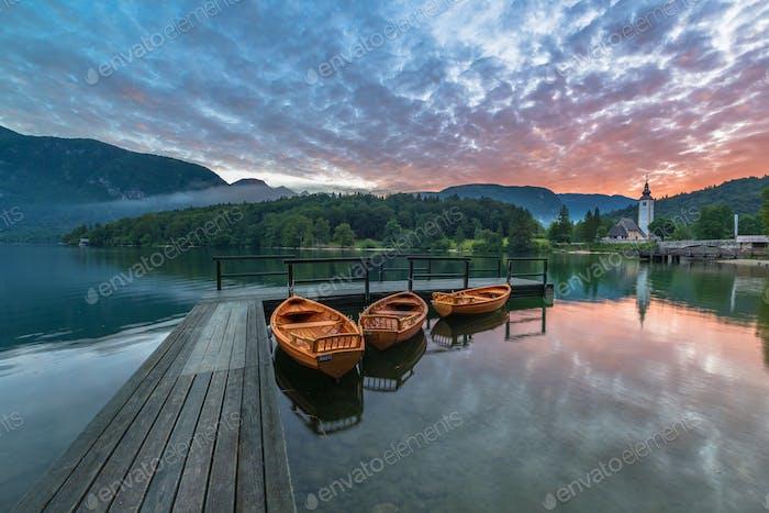 Vivid summer sunrise at Lake Bohinj in Slovenia