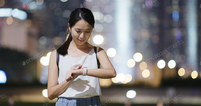 Woman use of smart watch at night